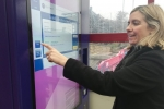 Andrea uses the new ticket machine